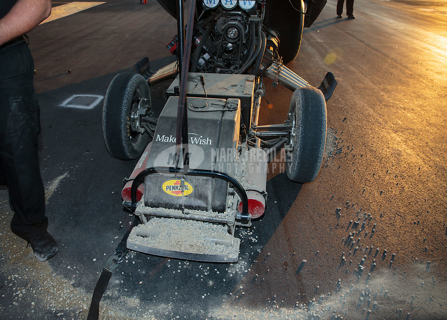 Nov 11, 2018; Pomona, CA, USA; Detailed view of dirtied rocks on the chassis of NHRA funny car driver Tommy Johnson Jr after he went into the sand trap during the Auto Club Finals at Auto Club Raceway. Mandatory Credit: Mark J. Rebilas-USA TODAY Sports