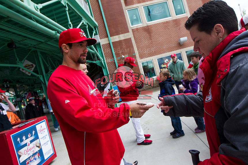 Adam Melker #4 of the Springfield Cardinals signs autographs for a fan prior to a game against the Tulsa Drillers at Hammons Field on May 4, 2013 in Springfield, Missouri. (David Welker/Four Seam Images)