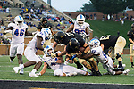 Cade Carney (36) of the Wake Forest Demon Deacons is brought down just short of the goal line by Robert Baker (23) of the Presbyterian Blue Hose at BB&T Field on August 31, 2017 in Winston-Salem, North Carolina.  The Demon Deacons defeated the Blue Hose 51-7.  (Brian Westerholt/Sports On Film)