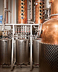 June 18, 2013. Chapel Hill, North Carolina<br />  The entire TOPO Distillery system is made by CARL Distilleries and is estimate to have cost over 1 million dollars.<br />  TOPO, Top of the Hill Distillery, the brainchild of owner Scott Maitland and Spirit Guide Esteban McMahan, is located in the old N&amp;O Building on Franklin Street. Making gin, vodka and American whiskey from locally sourced wheat, they are one of the few distilleries bringing  organic liquor to ABC shelves around the state.