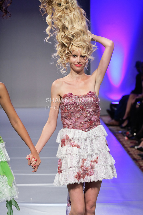 Model walks runway in an outfit by Andres Aquino, for the Andres Aquino Spring 2012 fashion show, during Couture Fashion Week Spring 2012.