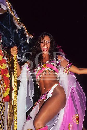Rio de Janeiro, Brazil. Samba school; gorgeous girl smiling in pink and white; Carnival.