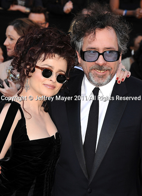 HOLLYWOOD, CA - FEBRUARY 27: Helena Bonham Carter and Tim Burton arrive at the 83rd Annual Academy Awards held at the Kodak Theatre on February 27, 2011 in Hollywood, California.