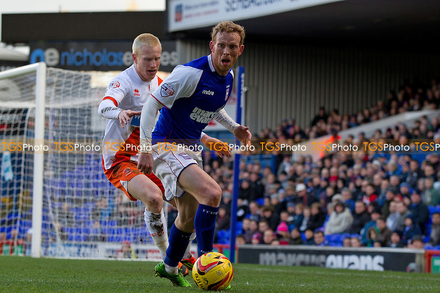 Paul Green of Ipswich Town tries to shake off the attention of David Perkins of Blackpool - Ipswich Town vs Blackpool - Sky Bet Championship Football at Portman Road, Ipswich, Suffolk - 15/02/14 - MANDATORY CREDIT: Ray Lawrence/TGSPHOTO - Self billing applies where appropriate - 0845 094 6026 - contact@tgsphoto.co.uk - NO UNPAID USE