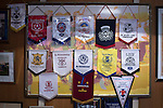 Harestanes AFC v Girvan FC, 15/08/2015. Scottish Cup preliminary round, Duncansfield Park. Souvenir pennants adorn the wall of the member's club at Kilsyth Rangers' Duncansfield Park ground where Harestanes AFC took on Girvan FC in a Scottish Cup preliminary round tie. The home team were the first winners of the Scottish Amateur Cup to be admitted directly into the Scottish Cup in the modern era, whilst the visitors participated as a result of being members of both the Scottish Football Association and the Scottish Junior Football Association. Girvan won the match by 3-0, watched by a crowd of 300, which was moved from Harestanes ground as it did not comply with Scottish Cup standards. Photo by Colin McPherson.