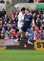Pictured L-R: Michu of Swansea clashes for a header against Scott Parker of Tottenham. Saturday 30 March 2013<br />