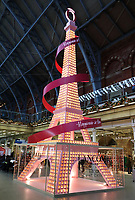 Lancome unveiled a new Installation of an illuminated replica of the Eiffel Tower in London's St Pancras railway station adjacent to the Eurostar hub. It will be an attraction at the station until Christmas. November 12th 2019<br /> <br /> Photo by Keith Mayhew