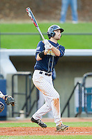 Christian Wolfe (21) of the UNCG Spartans follows through on a 2-run home run against the Georgia Southern Eagles at UNCG Baseball Stadium on March 29, 2013 in Greensboro, North Carolina.  The Spartans defeated the Eagles 5-4.  (Brian Westerholt/Four Seam Images)