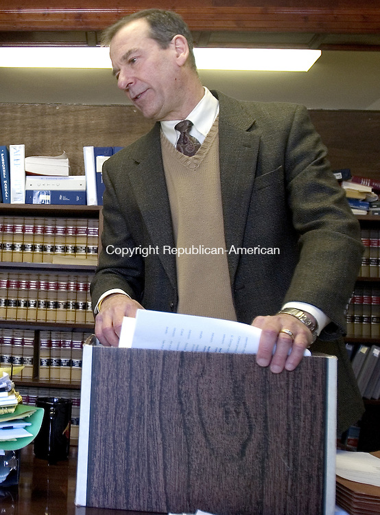 NAUGATUCK, CT 04 February 2008-020409SV11--Attorney Edward G. Fitzpatrick goes over copies of grievances and depositions against David Minnich in Minnich&rsquo;s case with Watertown during a press conference in Naugatuck Wednesday.<br /> Steven Valenti Republican-American