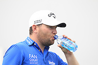 Branden Grace (RSA) hydrates on the 11th tee during Friday's Round 2 of the 2014 BMW Masters held at Lake Malaren, Shanghai, China 31st October 2014.<br /> Picture: Eoin Clarke www.golffile.ie