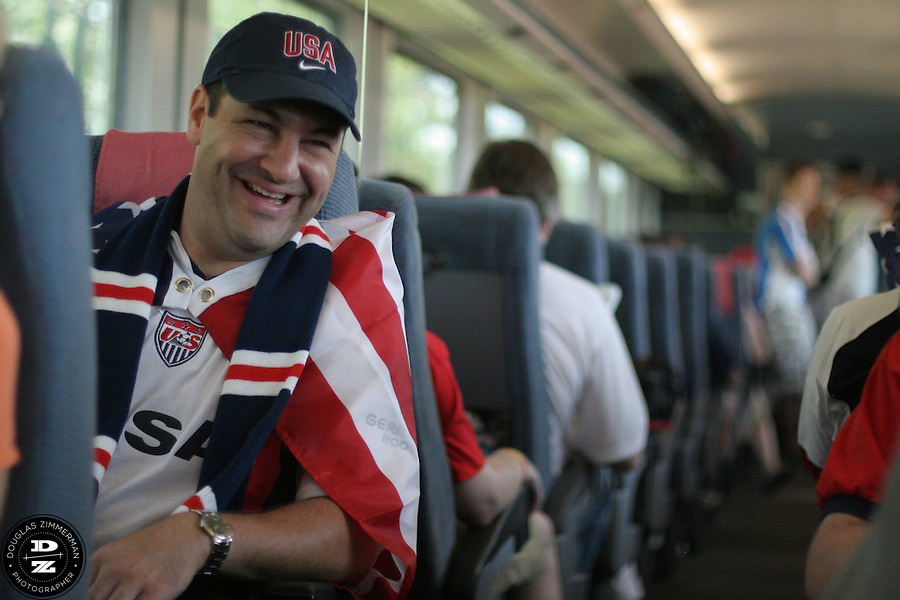 USA National Soccer Team fan Fabian McCarthy of Basking Ridge, N.J.  shares a laugh during a conversation with several other USA fans on a train ride from Cologne to Gelsenkirchen Germany for the USA's FIFA first round match against the Czech Republic on Monday June 12th, 2006 in Gelsenkirchen, Germany.  The United States lost lost the match 3-0.