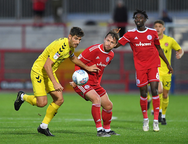 Fleetwood Town's Ched Evans battles with Accrington Stanley's Ross Sykes<br /> <br /> Photographer Dave Howarth/CameraSport<br /> <br /> EFL Leasing.com Trophy - Northern Section - Group B - Tuesday 3rd September 2019 - Accrington Stanley v Fleetwood Town - Crown Ground - Accrington<br />  <br /> World Copyright © 2019 CameraSport. All rights reserved. 43 Linden Ave. Countesthorpe. Leicester. England. LE8 5PG - Tel: +44 (0) 116 277 4147 - admin@camerasport.com - www.camerasport.com