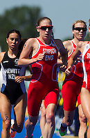 24 JUL 2014 - GLASGOW, GBR - Jodie Stimpson (ENG) (centre) from England starts her second run lap during the elite women's 2014 Commonwealth Games triathlon in Strathclyde Country Park, in Glasgow, Scotland (PHOTO COPYRIGHT © 2014 NIGEL FARROW, ALL RIGHTS RESERVED)<br /> *******************************<br /> COMMONWEALTH GAMES <br /> FEDERATION USAGE <br /> RULES APPLY<br /> *******************************