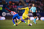Angel Montoro Sanchez (r) of UD Las Palmas runs the ball past Antoine Griezmann of Atletico de Madrid during their Copa del Rey 2016-17 Round of 16 match between Atletico de Madrid and UD Las Palmas at the Vicente Calderón Stadium on 10 January 2017 in Madrid, Spain. Photo by Diego Gonzalez Souto / Power Sport Images