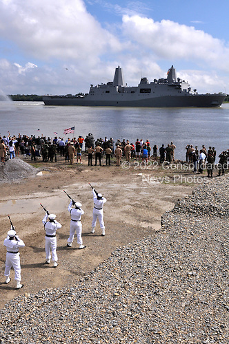 New Orleans, LA - October 13, 2009 -- In this photo provided by the United States Navy, members of the Naval Air Station Joint Reserve Base  New Orleans honor guard render honors to the amphibious transport dock ship Pre-Commissioning Unit (PCU) New York (LPD 21) as the ship transits the Mississippi River Tuesday, October 13, 2009, after departing Northrop Grumman Ship Systems in Avondale, Louisiana. New York has 7.5 tons of steel from the World Trade Center in her bow, and is scheduled to be commissioned November 7 in New York. .Mandatory Credit: John P. Curtis / US Navy via CNP