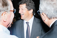 "Jay Faison, Founder and CEO of ClearPath Foundation, (center) speaks with Jack Gerard, president and CEO of the American Petroleum Institute, (right) before being on a panel put on by the Washington Post called ""Party Platform: Energy and Environment,"" at Butcher and the Brewer outside the Republican National Convention in Cleveland, Ohio, on Tues., July 19, 2016."