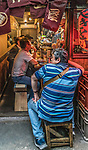 People sitting and enjoying the restaurants and bars in Piss Alley, Shinjuku, Tokyo, Japan