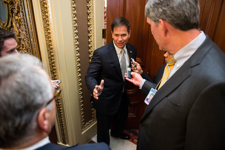 UNITED STATES - JUNE 11: Sen. Marco Rubio, R-Fla., speaks with reporters as he makes his to the weekly policy lunch in the Capitol on Tuesday, June 11, 2013.  (Photo By Bill Clark/CQ Roll Call)