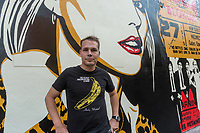 "New York, USA. 23rd Aug, 2017. Shepard Fairey, and his newly completed mural. The mural features Debbie Harry, lead singer for the rock group Blondie, who got their start in 1979 at CBGB which was located across the street. Fairy's work is also featured in Blondie's latest album ""Polinator"" which was released in May 2017. Credit: Stacy Walsh Rosenstock/Alamy Live News"
