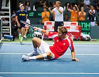 Switserland, Genève, September 19, 2015, Tennis,   Davis Cup, Switserland-Netherlands, Doubles: Chiudinelli goes down<br /> Photo: Tennisimages/Henk Koster