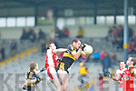 Dr Crokes Eoin Brosnan catches the kick out under pressure from Rathmore's George O'Keeffe during their Senior Club Championship semi final clash in Fitzgerald Stadium on Saturday