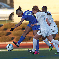 Under pressure, Boston Breakers forward Lianne Sanderson (10) takes a shot. In a National Women's Soccer League Elite (NWSL) match, the Boston Breakers (blue) tied the Washington Spirit (white), 1-1, at Dilboy Stadium on April 14, 2012.