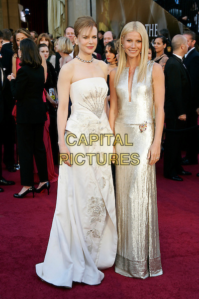NICOLE KIDMAN & GWYNETH PALTROW.83rd Annual Academy Awards - Oscars.Kodak Theatre, Hollywood, CA, USA..February 27th, 2011.full length pink white cream silver maxi dress strapless peplum.CAP/PE.©Peter Eden/Capital Pictures.