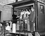 Regional officials of the Salvation Army and three canteen workers at the mobile canteen, which served thousands of meals in the flood area in the Brooklyn section. From left: Lt. Col. Ralph Miller, Mrs. Lillian Baker, Mrs. Anne Yaveckis, Mrs. Frank Duren and Lt. Col. David Coy.