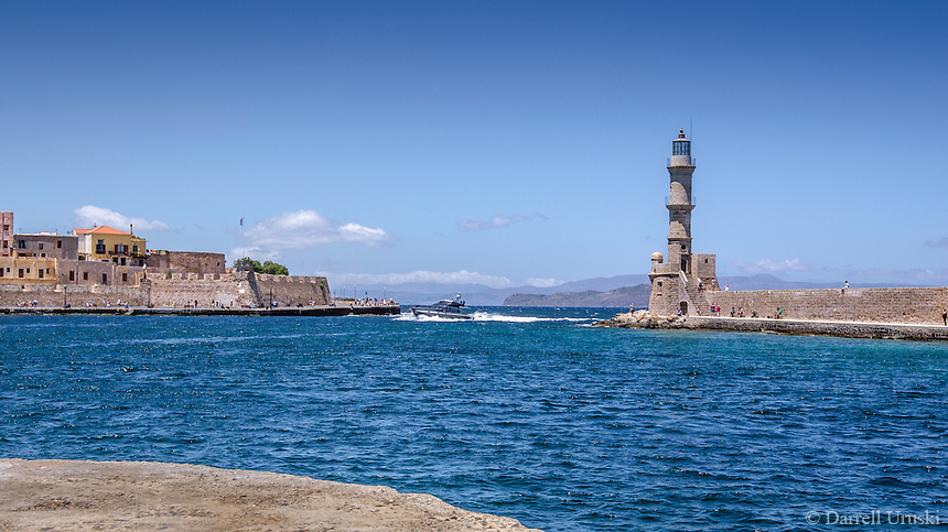Fine Art landscape Travel Art Print Photography, Of a walled light-tower guarding the bay and Port City of Chania, Crete, in Greece.