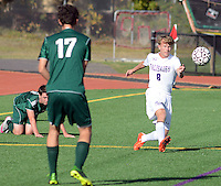 Palisades Michael Creighton #8 kicks the ball into play as  Lansdale Catholic's Will Rex #17 defends in the first half at Palisades High School Monday October 5, 2015 at Kintnersville, Pennsylvania.  (Photo by William Thomas Cain)