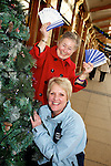 Pix: Shaun Flannery/shaunflanneryphotography.com...COPYRIGHT PICTURE>>SHAUN FLANNERY>01302-570814>>07778315553>>..11th December 2010...............Lakeside Village, Doncaster..Voucher competition winner Janet Crowther receives her vouchers from Cheryl Sadler, Manager of Lakeside Village..