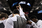 14 March 2015: Notre Dame players huddle before the game. The Notre Dame Fighting Irish played the University of North Carolina Tar Heels in an NCAA Division I Men's basketball game at the Greensboro Coliseum in Greensboro, North Carolina in the ACC Men's Basketball Tournament quarterfinal game. Notre Dame won the game 90-82.