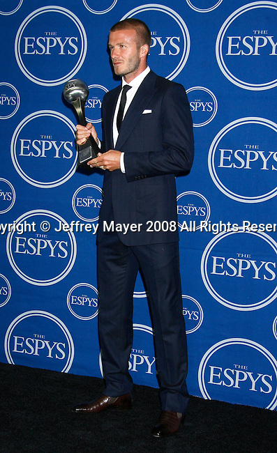 MLS player David Beckham poses with 'Best MLS Player' in the press room at the 2008 ESPY Awards held at NOKIA Theatre L.A. LIVE on July 16, 2008 in Los Angeles, California.