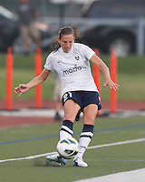 Seattle Reign FC midfielder Kristen Meier (21) clears the ball.  In a National Women's Soccer League (NWSL) match, Seattle Reign FC (white) defeated Boston Breakers (blue), 2-1, at Dilboy Stadium on June 26, 2013.