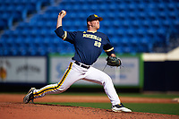 Michigan Wolverines relief pitcher Mac Lozer (29) delivers a pitch during the second game of a doubleheader against the Canisius College Golden Griffins on February 20, 2016 at Tradition Field in St. Lucie, Florida.  Michigan defeated Canisius 3-0.  (Mike Janes/Four Seam Images)