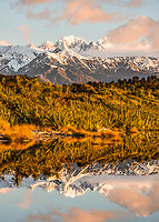 Sunset over Southern Alps with Mt. Tasman and Mt. Cook from Three Mile Lagoon, Westland National Park, West Coast, UNESCO World Heritage Area, New Zealand, NZ