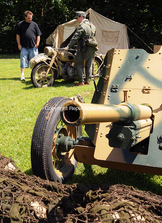 WATERBURY, CT 31  JULY, 2010-073110JS02-Will Burnes of Granby, right, a member of the The 3rd Panzer Grenadier Division  Living History Group talks with Rob Pelkey of Waterbury as they look over a WWII motorcycle on display at Vet Fest D'Ville at Waterville Park in Waterbury.  Proceeds from the event will benefit the Waterbury Veterans Memorial Committee. <br /> Jim Shannon Republican-American