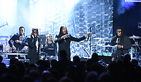 NEW YORK - JANUARY 27: Migos perform at the 2018 Clive Davis Pre-Grammy Gala at the Sheraton New York Times Square on January 27, 2018 in New York, New York. (Photo by Frank Micelotta/PictureGroup)