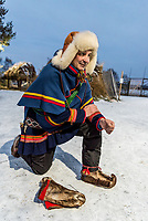 Nils Torbjörn Nutti, owner of Nutti Sámi Siida, is a reindeer herder from a mountain village called Saarivuoma, and he dons a simple dark blue tunic with prominent yellow and red embroidery underneath his poncho called a luhkka.