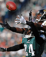 Jacksonville Jaguars receiver #19 Ernest Wilford reaches over the head of Philadelphia Eagles cornerback #24 Sheldon Brown but the ball fell incomplete at Lincoln Financial Field in Philadelphia, PA. (The Florida Times-Union, Rick Wilson)