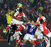 BOGOTA, COLOMBIA -ABPRIL 6: Robinson Zapata goalkeeper  (Left)  of Millonarios struggles for the ball with  Francisco Meza (Right)  of Santa Fe  during a match between Santa Fe and Millonarios  as part of the Liga Postobon I 2013 at Nemesio Camacho El Campin Stadium onApril 6 , 2013 in Bogota , Colombia. (Photo /VizzorImage /Felipe Caicedo /Staff)