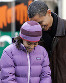 Chicago, IL - November 26, 2008 -- United States President-elect Barack Obama and daughter Malia share a moment as they take a break from passing out food at St. Columbanus Parrish and School Wednesday, November 26, 2008, in Chicago, Illinois. .Credit: Frank Polich - Pool via CNP