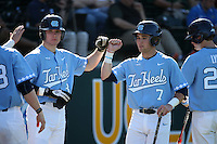 Logan Warmoth (7) of the North Carolina Tar Heels greets teammate Kyle Datres (8) during a game against the UCLA Bruins at Jackie Robinson Stadium on February 20, 2016 in Los Angeles, California. UCLA defeated North Carolina, 6-5. (Larry Goren/Four Seam Images)