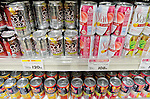 """Tokyo, Japan - Colorful canned alcoholic drinks are on the shelves at a store in Tokyo. Chu-hi, which is a type of a alcoholic drink, is a favorite among many Japanese people. The name, """"Chu-hi"""" is a derived form of a combination of """"shochu and highball."""" Chu-hi companies often launch limited edition themed drinks to celebrate the different seasons in Japan.(Photo by Yumeto Yamazaki/AFLO)"""