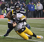 Seattle Seahawks linebacker K.J. Wright (50) tackles Pittsburgh Steelers quarterback Ben Roethlisberger (7) after a short gain at CenturyLink Field in Seattle, Washington on November 29, 2015.  The Seahawks beat the Steelers 39-30.      ©2015. Jim Bryant Photo. All Rights Reserved.