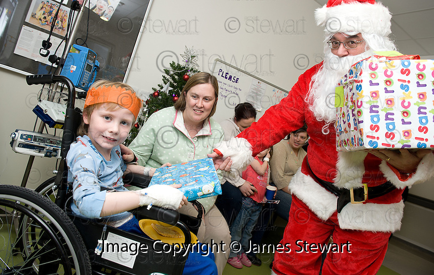 SANTA AND HIS HELPERS DELIVER PRESENTS TO THE CHILDREN AT FORTH VALLEY ROYAL HOSPITAL'S CHILDRENS WARD