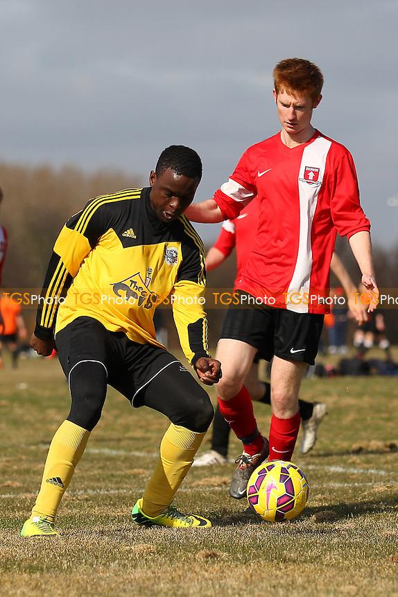 Boroughs United (yellow) vs Top Red - Hackney & Leyton Sunday League Junior Cup Semi-Final Football at East Marsh, Hackney Marshes, London - 08/03/15 - MANDATORY CREDIT: Gavin Ellis/TGSPHOTO - Self billing applies where appropriate - 0845 094 6026 - contact@tgsphoto.co.uk - NO UNPAID USE