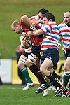 Dave Duley fights his way through 2 Tasman tacklers. Air New Zealand Air NZ Cup warm-up rugby game between the Counties Manukau Steelers & Tasman Mako's, played at Growers Stadium Pukekohe on Sunday July 20th 2008..Counties Manukau won the match 30 - 7.