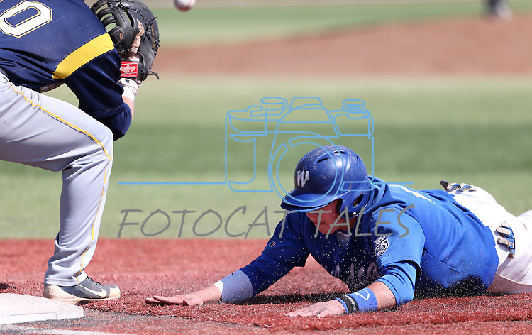Western Nevada's AJ Hernandez dives back to first during a college baseball game against Southern Nevada in Carson City, Nev., on Friday, March 22, 2013..Photo by Cathleen Allison
