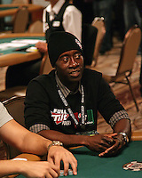 DON CHEADLE.The Ante Up for Africa Celebrity Poker Tournament at the Rio Resort Hotel and Casino, Las Vegas, Nevada, USA..July 2nd, 2009.half length table bet betting chips  cards black hat top .CAP/ADM/MJT.© MJT/AdMedia/Capital Pictures